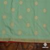 Sea Green Handloom Banarasi With A Striking Red Salvage