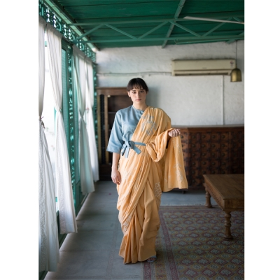 Peach handwoven khadi with white and blue Chikankari motifs