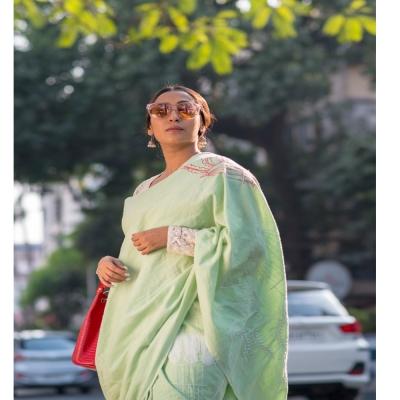 Pale green handwoven khadi with intricate Chikankari work