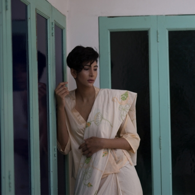 A handloom khadi in a wonderful shade of white with lemon yellow and lush green Chikankari work