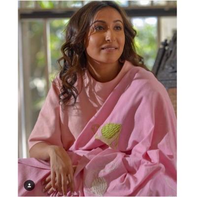 Pastel pink handloom khadi adorned by  beautiful butterscotch bird motifs