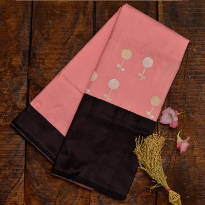 Soft peach handwoven katan banarasi with contrasting border