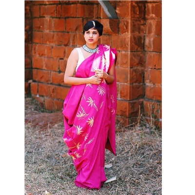 Fuschia handwoven khadi sari strewn with lemon yellow flowers
