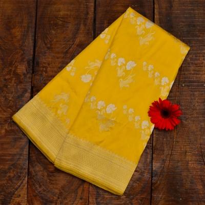 Yellow handloom banarasi with allover silver and gold zari work