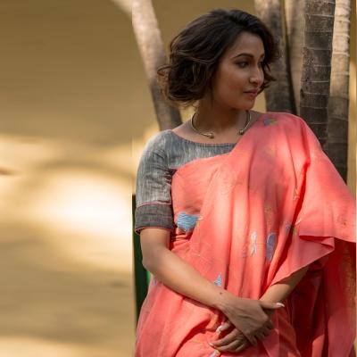 Pretty peach handwoven khadi sari with beautiful fresh flower Chikankari motifs