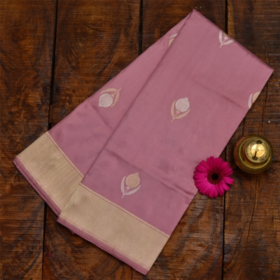 Dusky pink banarasi with paan bootas is gold and silver