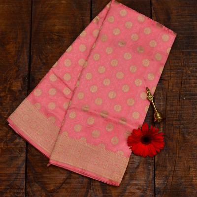 The sweet peach coloured katan banarasi with evergreen polka dots
