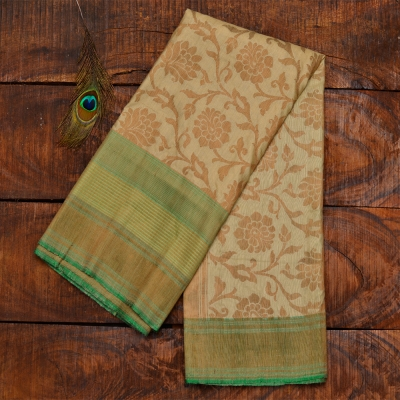 Dull cream pure katan banarasi with muted gold jangla zari work and green border