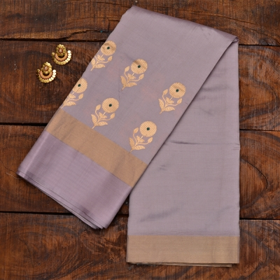Pale purple and grey handloom katan banarasi with golden flowers