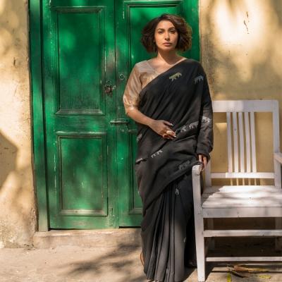 Black handwoven khaddar sari with white and yellow Chikankari weave of Lucknow