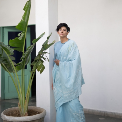 Serene sky blue khadi sari with splendid Chikankari weave in yellow and white