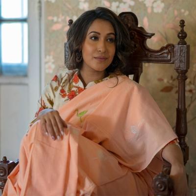 Pristine peach handwoven khadi with chic Chikankari motifs