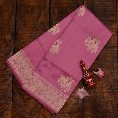 Dusty rose pink  banarasi with elegant meenakari and golden weave
