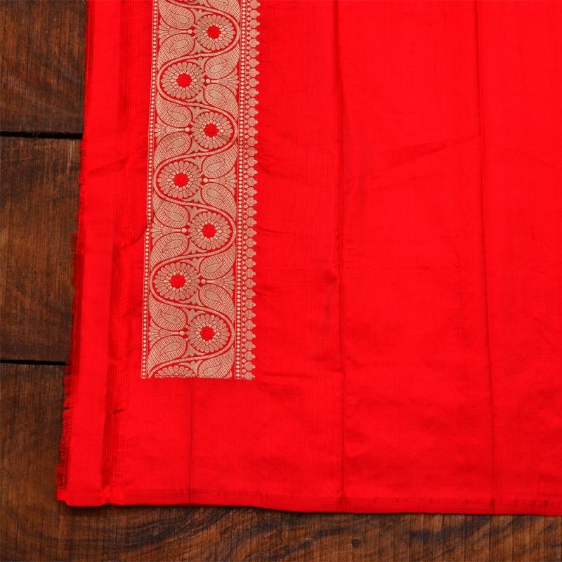 Red handspun katan banarasi with silver and golden flowers